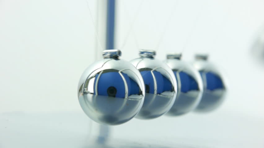 Newton's Cradle pendulum close up over white background with sound. - HD stock video clip