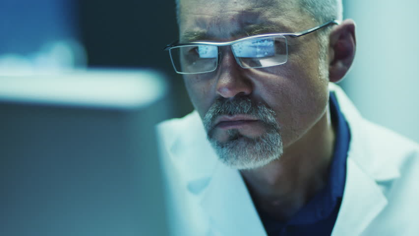 Serious and Focused Scientist Working on Computer. Shot on RED Cinema Camera in 4K (UHD). | Shutterstock HD Video #9421880