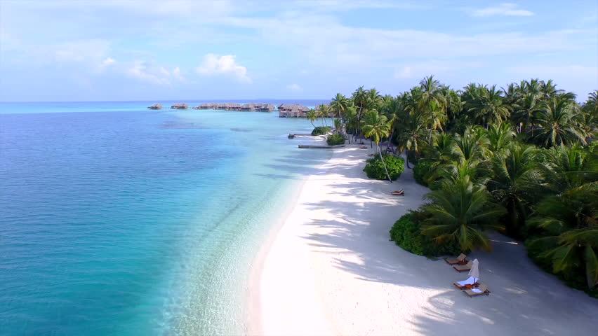 AERIAL: Luxury island resort on exotic white sand beach | Shutterstock HD Video #9426038