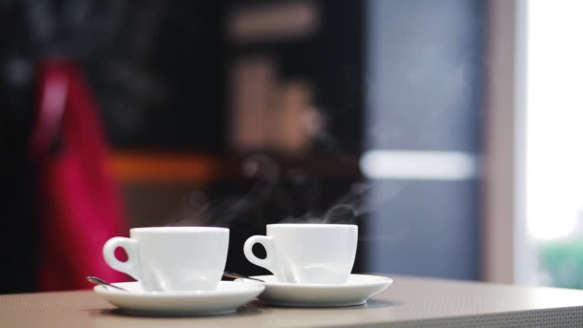 Steam coming from a white cup | Shutterstock HD Video #9470597
