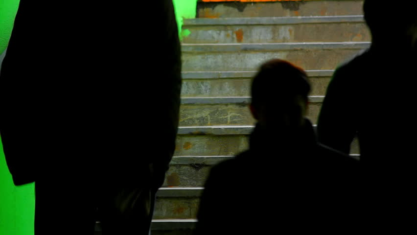 People on dark green staircase. Different people waling up and down the stairs. Source: Canon 7D, graded.
