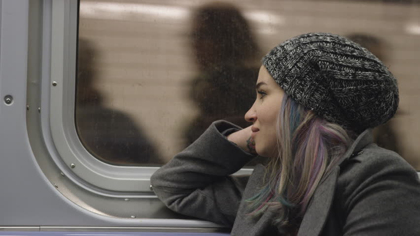 Girl Riding MTA Subway Train - Pretty Urban Lady with Dyed Hair - Raver Commuting in New York City 4K | Shutterstock HD Video #9512213