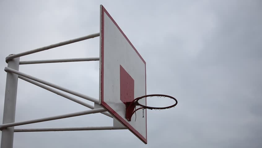 Video flown hoops on the basketball school playground in the park in the evening - HD stock video clip