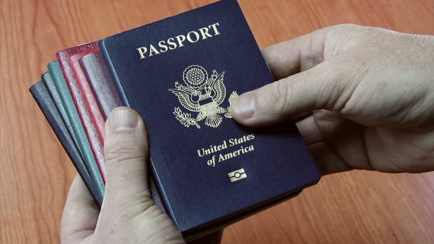 Close up shot of a man's hands sorting through various country's passports. - HD stock video clip