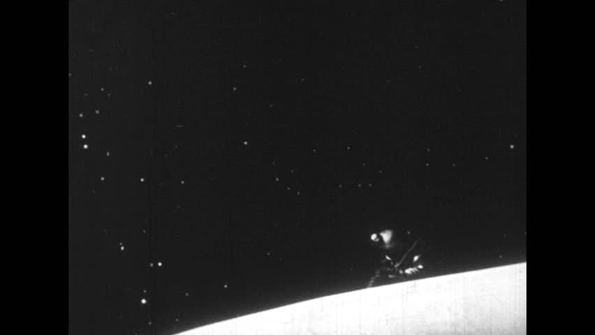 GERMANY 1940s - An astronaut gets out of his ship and wanders around in space. - HD stock footage clip