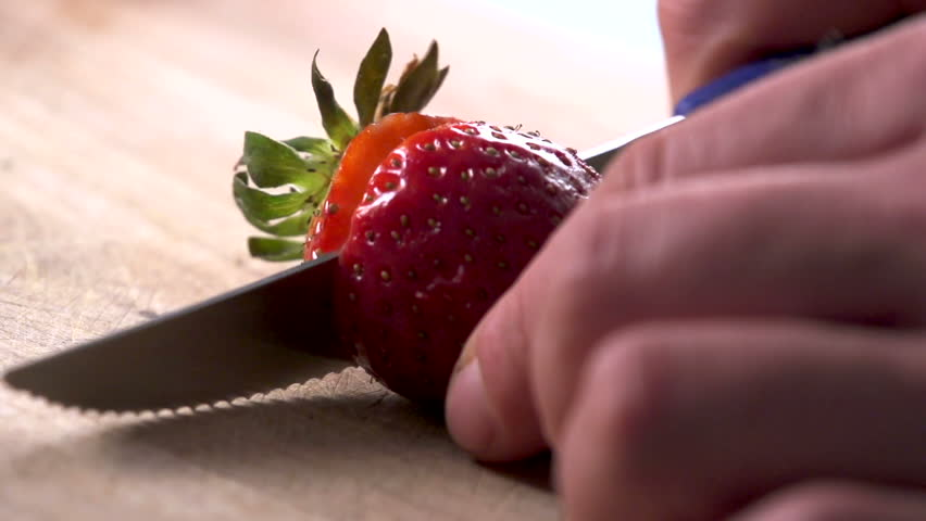 Strawberry slicing in slow motion. Find similar in our portfolio. - HD stock video clip