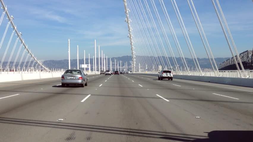 San Francisco, CA - 16 Feb, 2015: A car passes Bay Bridge, in San Francisco, CA on 16 February 2015.