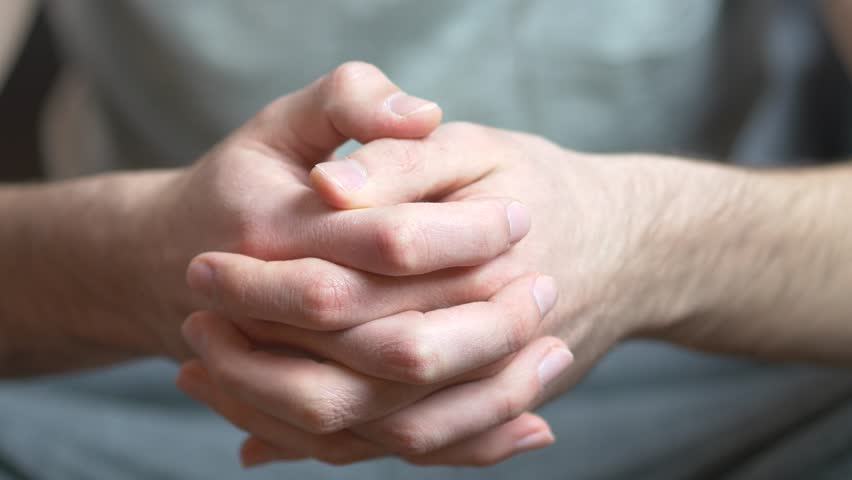 Hands of a caucasian adult man being anxious, nervous and uncomfortable.