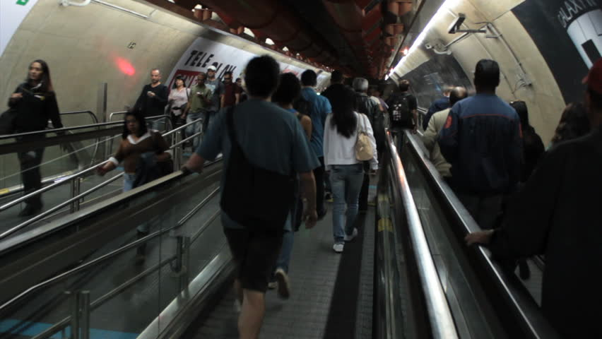 SAO PAULO, BRAZIL - CIRCA MAY: Escalator at the Sao Paulo subway - Metro SP. Brazil – Passangers at the Metro SP, corridor to connect Consolação and  Paulista station. May 2014  | Shutterstock HD Video #9675383