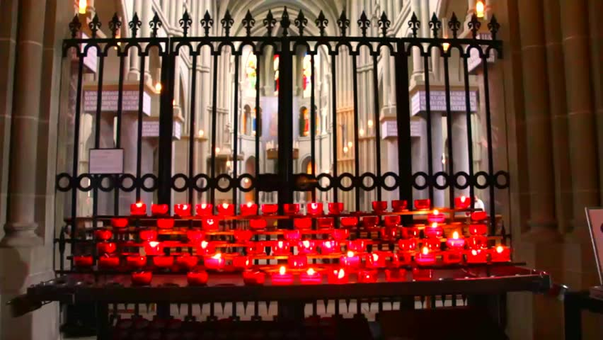 BERN, SWITZERLAND - AUGUST 14: Candles at the  Cathedral on August 14, 2013 in Bern, Switzerland - HD stock footage clip