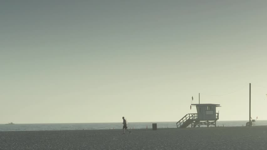 Lifeguard post on a Santa Monica beach at dusk/dawn (variation). - HD stock video clip