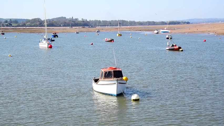 Boats on River Exe, near the mouth of the river - HD stock footage clip