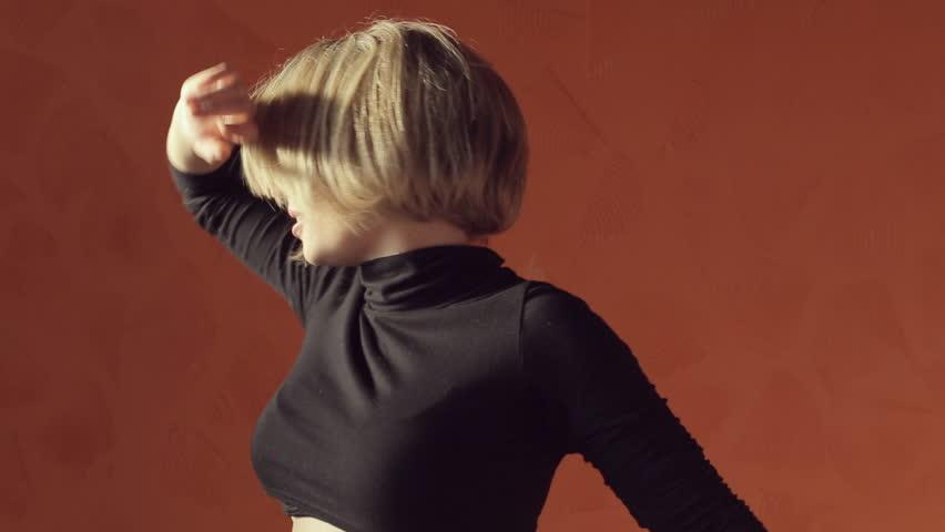 Vigorous sexy blond woman dancing twerk - HD stock footage clip