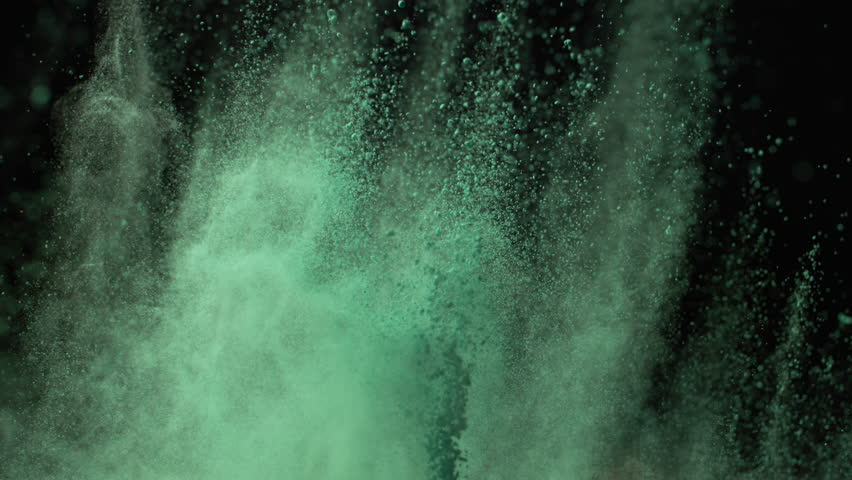 Powder exploding against black background. Shot with high speed camera, phantom flex 4K. Slow Motion. Unedited version is included at the end of clip.