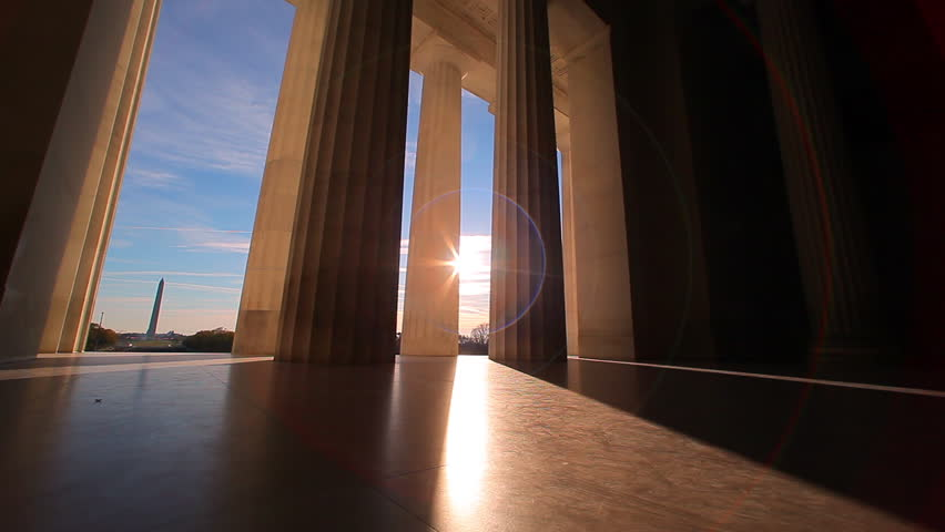 Washington, DC/United States - November 2012: A tracking shot with a lens flare of the bottom of the pillars of the Lincoln Memorial. | Shutterstock HD Video #9776948