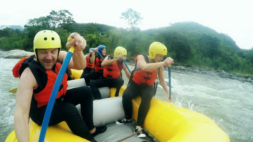 Adult Caucasian Family Having Fun On White Water Rafting Trip, On Board Mounted Camera, Model Released High Quality Footage With Sound  | Shutterstock HD Video #9805910