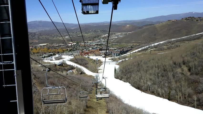 Park City, Utah - April, 2015 - Reverse view of going up a ski lift in ultra high definition (UHD).