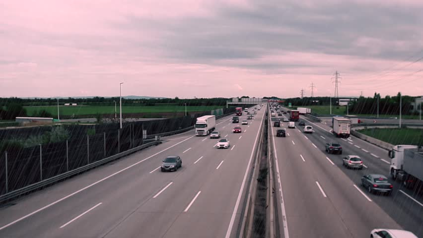 traffic on highway on rainy day,bad day for traveling, fast cars traveling on the highway ,abstract speed transportation background,speed traffic background time lapse - HD stock video clip