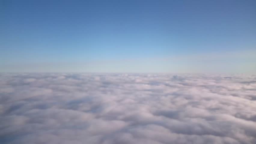 Flying in the air with clouds passing by. Medium shot from an aerial perspective of moving clouds Cloudscape of skies    Shutterstock HD Video #9924431