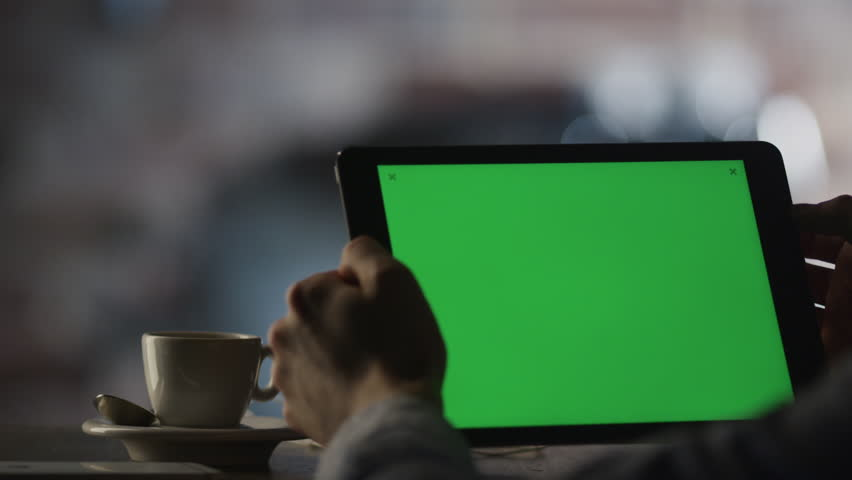 Using Tablet PC with Green Screen in Landscape Mode In Cafe. Shot on RED Cinema Camera in 4K (UHD).