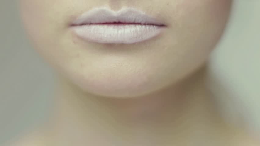 Camera panning to lips that smiling. Shallow depth of field