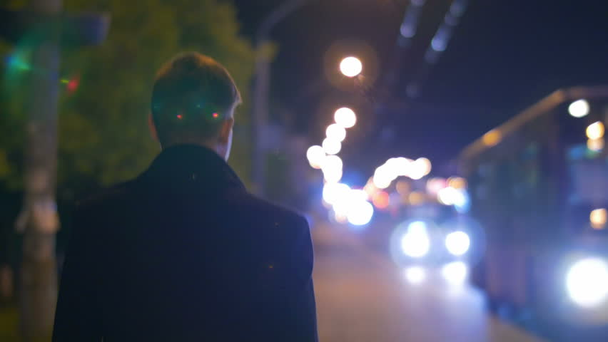 3 in 1 videos! The man walk at the night city alley. Car ride background him. Shot with Red Cinema Camera